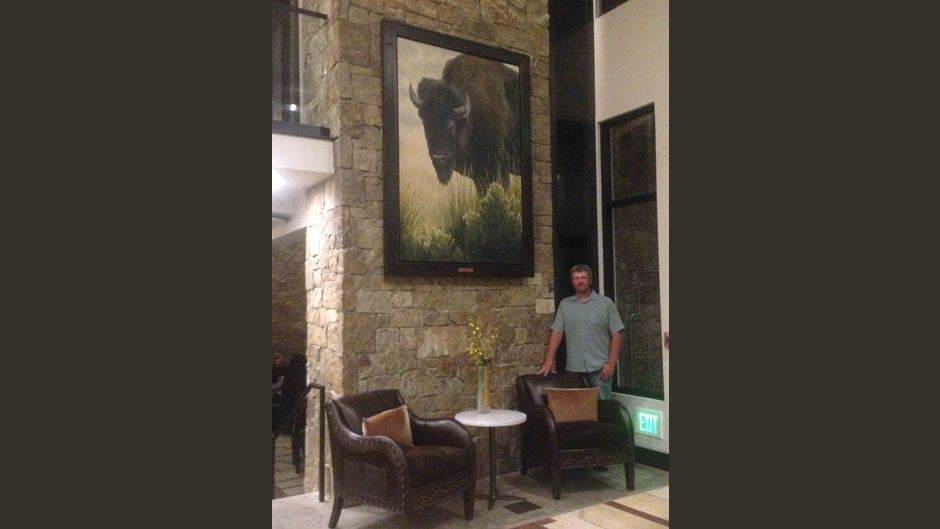 Aaron Yount with Bison Painting at Hotel Jackson